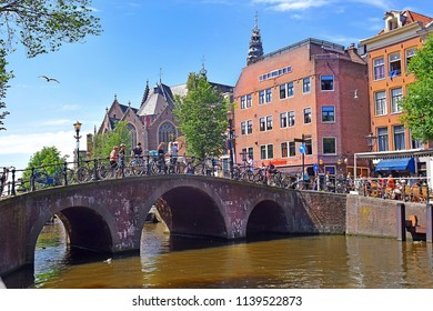 Amsterdam, North Holland, The Netherlands - May 20 2018: picturesque cityscapes in the red-light district of Amsterdam. Amsterdam is the capital and most populous city of the Netherlands
