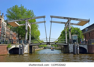 Amsterdam, North Holland, The Netherlands - May 20 2018: trip through the picturesque canals of Amsterdam. Amsterdam is the capital and most populous city of the Netherlands