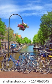 Amsterdam, North Holland, The Netherlands - May 21, 2018: picturesque cityscapes in the red-light district of Amsterdam. Amsterdam is the capital and most populous city of the Netherlands