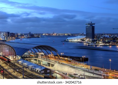 AMSTERDAM - NOVEMBER 13: Twilight scene of Amsterdam's Ij River with the new landmarks A'dam Toren and The Eye across the water from the Central Station on the evening of November 13th, 2015.