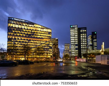 Amsterdam, November 2017. Night view of the financial, economic and judicial center in Amsterdam, known as the 'Zuidas' with illuminated office towers against a dark blue evening sky