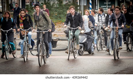 AMSTERDAM - NOVEMBER 5, 2015: Cyclists battle rush hour traffic in Amsterdam. The Dutch love their bicycles.