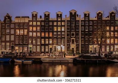 AMSTERDAM - NOVEMBER 5, 2015: Typical Dutch buildings along a canal in the heart of Amsterdam.
