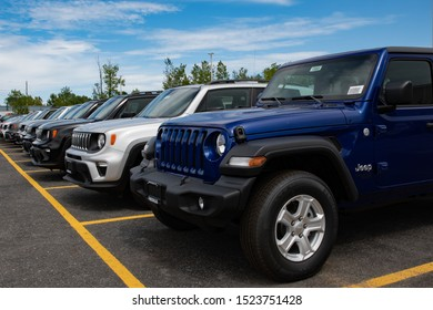 Amsterdam, NY - August 27, 2019:  A line of new vehicles on a dealers lot including a Jeep Wrangler Unlimited and several Jeep Renegades.
