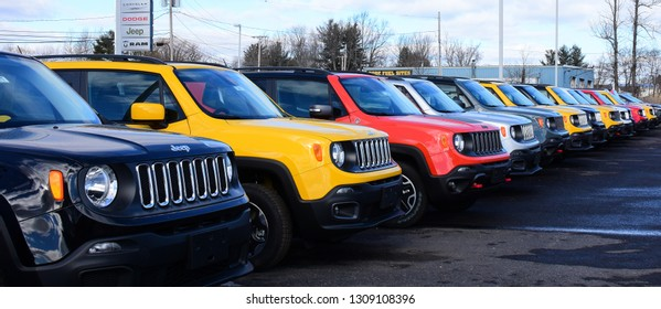 Amsterdam, NY - February 2, 2016: A line of new Jeep Renegade compact sport utility vehicles for sale on a dealer lot.