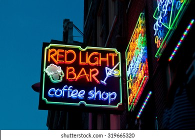 AMSTERDAM - OCT 31: Night image of colorful coffee shop signs in the red district on October 31, 2011, in Amsterdam, the Netherlands. It is probably the most famous tourist site in town.