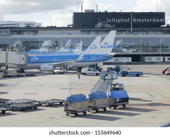 AMSTERDAM - OCT 6: KLM plane being loaded at Schiphol Airport on October 6, 2012 in Amsterdam, Netherlands. There are 163 destinations served by KLM, many are located in the Americas, Asia and Africa