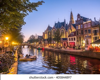 AMSTERDAM - OCTOBER 2: The Old Church in Red-light district under twilight evening sky in Amsterdam, Netherlands, on October 2, 2015.