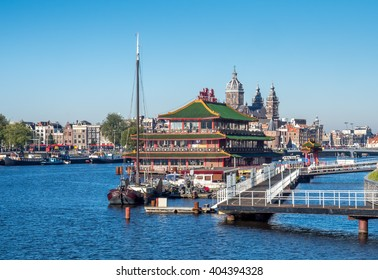 AMSTERDAM - OCTOBER 2: Saint Nicholas church with surround transportation canal and bicycle in Amsterdam, Netherlands, on October 2, 2015.