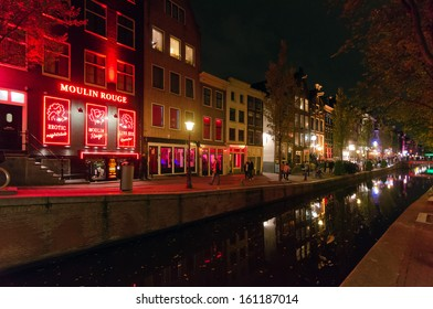 AMSTERDAM - OCTOBER 22, 2013: Red-light district in Amsterdam on October 22, 2013 in Amsterdam, Netherlands. There are about three hundred cabins rented by prostitutes in the area.