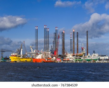 Amsterdam, Oktober 2017. Damen Shipyard seen from across the water with several ships, drilling platforms and cranes