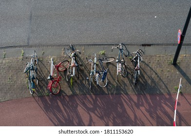 Amsterdam parked bikes on pavement from above