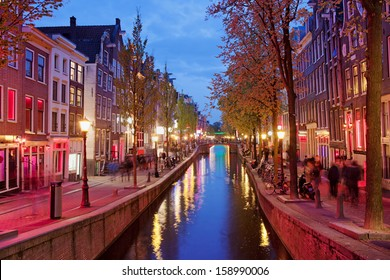 Amsterdam Red Light District area in the city centre at dusk, North Holland, the Netherlands.