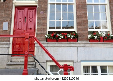 Amsterdam residential street - generic old house ornate door. Netherlands rowhouse.