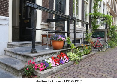 Amsterdam residential street - Keizersgracht canal buildings. Netherlands rowhouse.