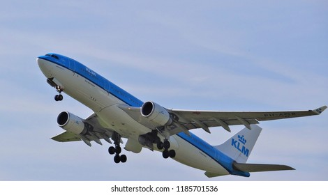 Amsterdam Schiphol Airport / Netherlands - August 28 2017: A KLM passenger plane is taking off from the runway at Schiphol. It is a blue and white airplane