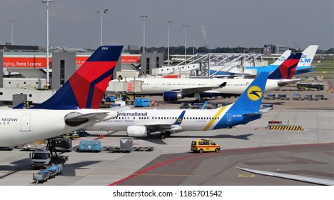 Amsterdam Schiphol Airport / Netherlands - August 28 2017: Many different airplanes of many different organisations at the terminal of Schiphol Airport. The planes are waiting for departure