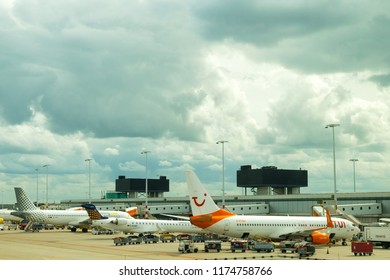 AMSTERDAM, SCHIPHOL, NETHERLANDS, AUGUST 24, 2018: TUI and Vueling ariplanes at the gate at Schiphol Airport