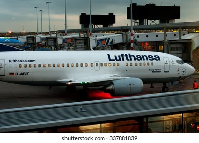 Amsterdam - Schiphol, Netherlands - February 2, 2014. Airlines Lufthansa  Boeing-737  at Schiphol Airport in the evening