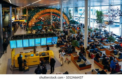 Amsterdam Schiphol, Netherlands - Jan 13, 2018: Passengers at Amsterdam's Schiphol Airport, which services 63.5 million passengers a year