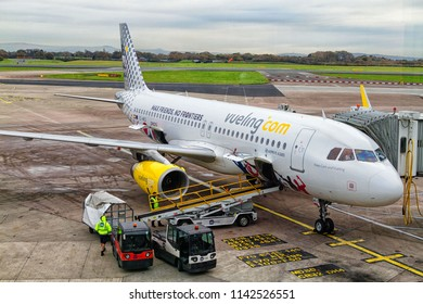 AMSTERDAM SCHIPHOL, NETHERLANDS - NOVEMBER 13: Vueling Airbus A320 parks at gate at Schiphol Airport in Amsterdam.