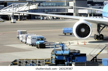 AMSTERDAM SCHIPHOL,HOLLAND-November 1, 2014;Loading an airplane with airfreight at Schiphol airport.November 1, 2014, Amsterdam Schiphol, Holland