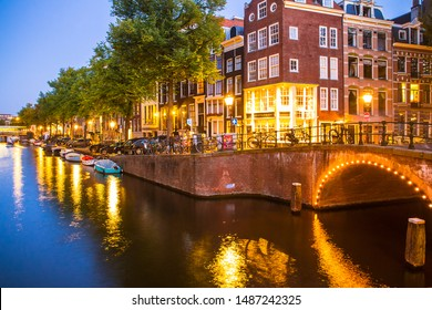 Amsterdam seen in the evening with light, canal and bridge
