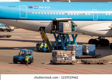 AMSTERDAM - SEP 9, 2012: KLM Airbus A330 airliner being loaded with air freight at Amsterdam Schiphol international airport.