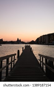 amsterdam skyline at dusk , view from the pier