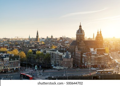 Amsterdam skyline in historical area at night, Amsterdam, Netherlands. Aerial view of Amsterdam, Netherlands. Landscape and nature travel, or historical building and sightseeing concept