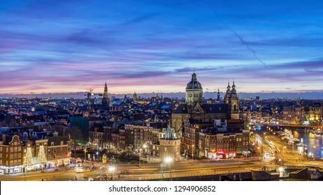 Amsterdam skyline at night, the Netherlands. Panorama view