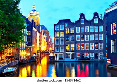 Amsterdam: St. Nicolas Church and Canals at dusk.