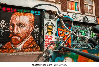Amsterdam street art - icons. Amsterdam, the Netherlands - April 5, 2013: Parked bicycles in front of a graffiti decorated facade with a self-portrait of Vincent Van Gogh, icon of the city.