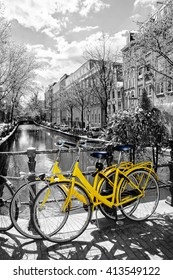 Amsterdam street scene. Bicycles against a backdrop of traditional old dutch houses on the bridge in spring, Netherlands