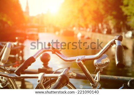 Amsterdam view with bicycles under sun light