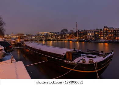 Amsterdam -  View to illuminated Magere Brug at Night at  Amstel River in Wintertime,  Nordholland, Netherlands, Amsterdam, 22.01.2019