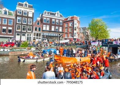 AMSTERDAM-APRIL 27: Crowd of people on the boats participate in celebrating King's Day on April 27,2015. King's Day (formerly Queen's Day) has become more and more of an open air party.