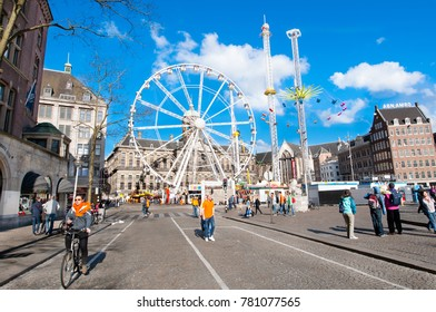 AMSTERDAM-APRIL 27:  Dam Square and Royal Palace on the background during  festivities on the King's Willem- Alexander birthday, held each year on April 27, 2015 in Amsterdam.