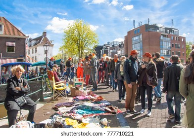 AMSTERDAM-APRIL 27:  Locals display their old things for sale in down town of Amsterdam on King's Day on April 27, 2015. Kings Day is the biggest festival celebrating the birth of Dutch royalty.