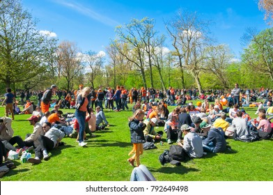 AMSTERDAM-APRIL 27: People in orange celebrate King's Day in on April 27,2015 in Vondelpark, the Netherlands.The Vondelpark is the largeat and public urban park in Amsterdam, the Netherlands.