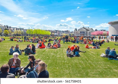 AMSTERDAM-APRIL 27: People relax at the Museumplein on King's Day on April 27,2015. Museumplein is a public space between three museums: Rijksmuseum, Van Gogh Museum, and Stedelijk Museum.
