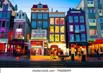 AMSTERDAM-APRIL 27: Rokin street at night with illuminated shops on April 27,2015 in Amsterdam. Rokin is a major street in Amsterdam, the Netherlands.