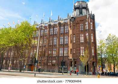 "AMSTERDAM-APRIL 27: Scheepvaarthuis by architect Van der Mey on April 27,2015. The Scheepvaarthuis (Shipping House) is considered a masterpiece of the ""Amsterdamse School"" architectural style."