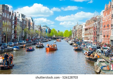 AMSTERDAM-APRIL 27: View of  Amsterdam Singel canal full of boats during King's Day on April 27,2015. King's Day is the biggest festival celebrating the birth of Dutch royalty.