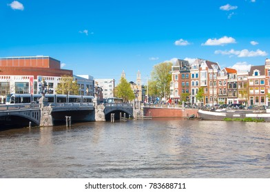 Amsterdam-April 30: Amsterdam cityscape with the Blauwbrug bridge on April 30,2015. The Blauwbrug  or blue bridge is a bridge connecting the Rembrandtplein with the Waterlooplein.