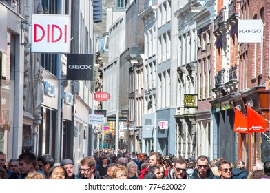 AMSTERDAM-APRIL 30: Crowd of people go shopping on famous Kalverstraat street, on April 30,2015, the Netherlands. The Kalverstraat is a busy shopping street of Amsterdam.