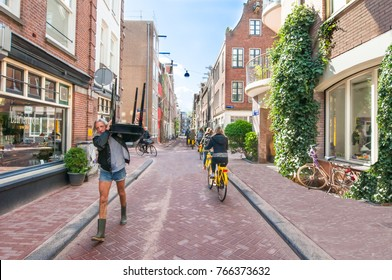 AMSTERDAM-APRIL 30: Jordaan neighbourhood, tourists ride bicycles on April 30,2015. The Jordaan is a neighbourhood of the city of Amsterdam with its famous art galleries, particularly for modern art.
