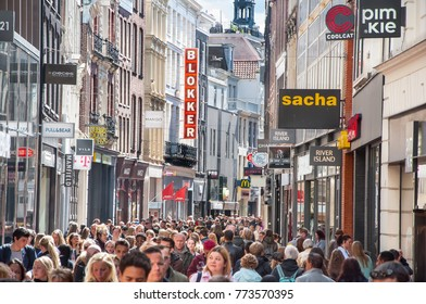 AMSTERDAM-APRIL 30: Kalverstraat shopping street with different international brands on both sides, people go shopping on April 30,2015. in Amsterdam, the Netherlands.