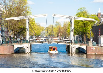 Amsterdam-April 30: Magere Brug (Skinny Bridge) as seen from the water on April 30, 2015. Bridge provides a nice spot to take in sweeping views of the Amstel river with the Carre Theatre close by.