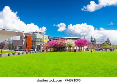 AMSTERDAM-APRIL 30: The Museumplein (Museum Square) surrounded by the most important museums in Amsterdam such as Van Gogh Museum, the Rijksmuseum the Stedelijk on April 30,2015. The Netherlands.